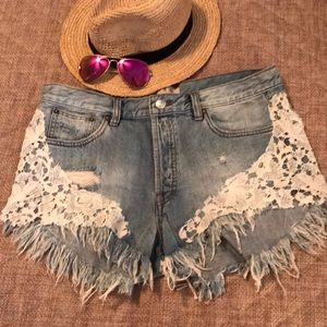 Free People frayed jean shorts with lace detail!
